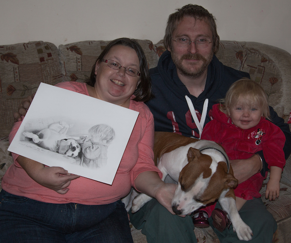 Recipients of drawing sitting on sofa